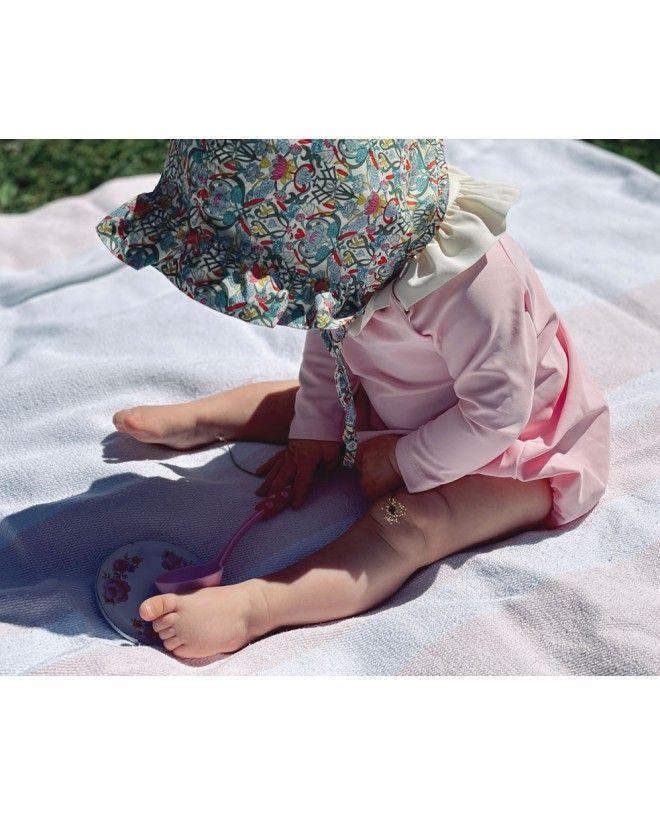 Chapeau anti UV pour bébé fille en tissu Liberty de Canopea