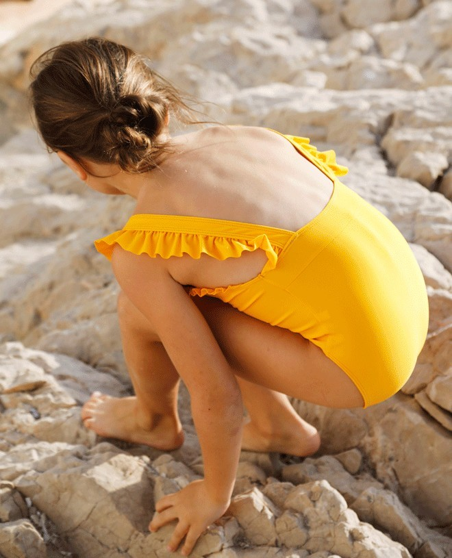 Sunflower yellow sun protective swimwear for girl and baby by Canopea x Smallable
