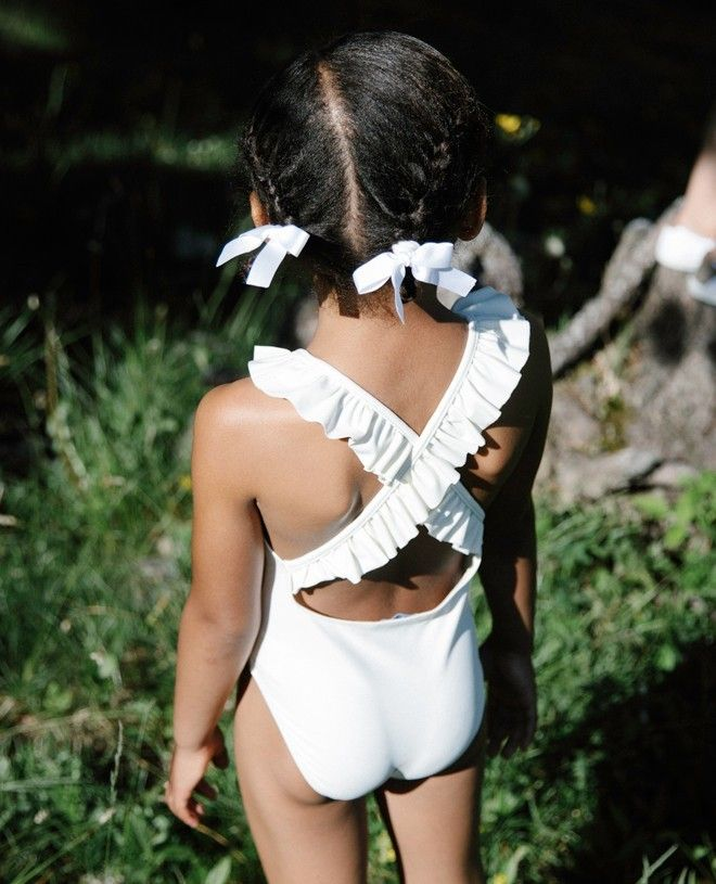 Vanilla sun protective one piece swimsuit with crossed back straps for girls