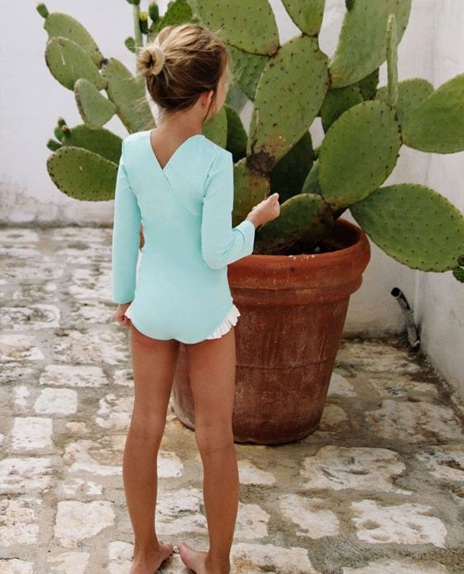 Long sleeve sun protective swimsuit for girls in aqua green