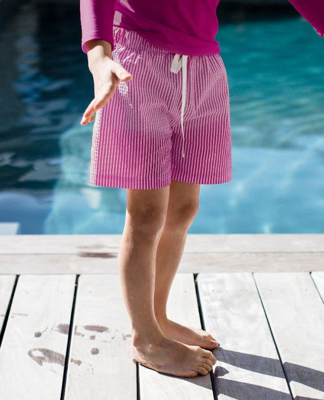 Plum red seersucker swim shorts for boys by Canopea