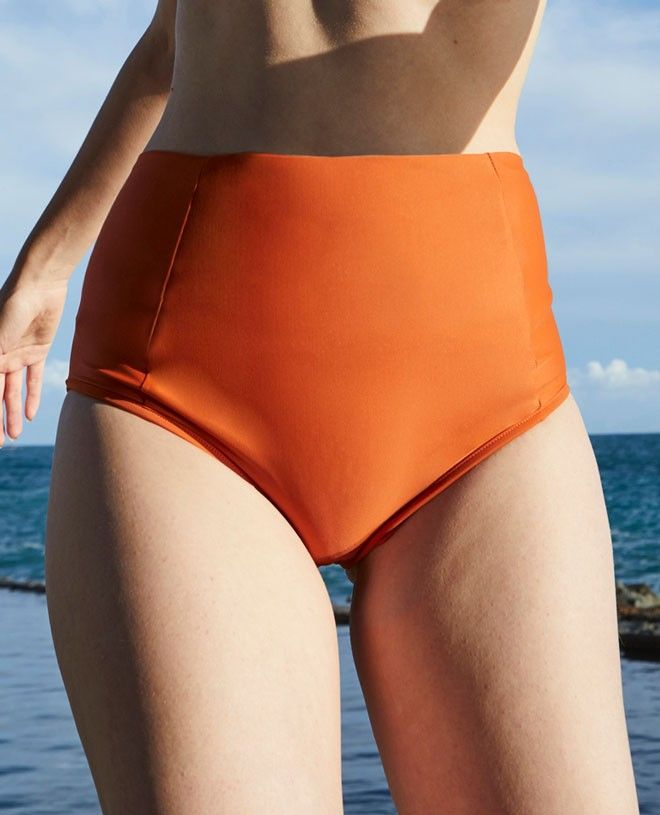 Sun protective bikini bottom for women LEANDRA in saffron orange by Canopea