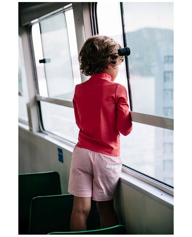 Boy wearing Fragola red seersucker swim shorts by Canopea