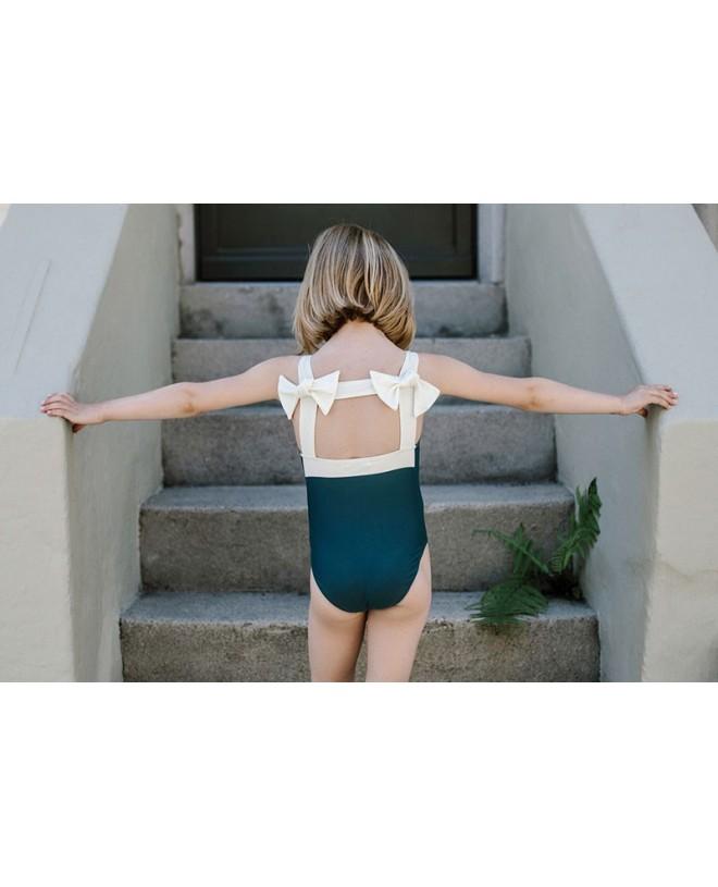 Girl wearing the Stone Pine green sun protective swimwear Layla by Canopea