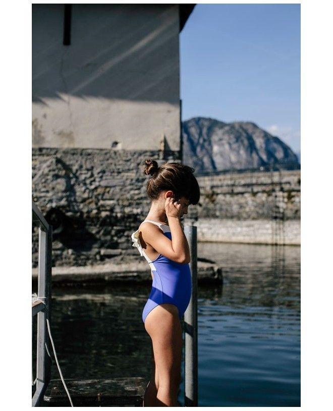 Girl wearing the Indigo blue sun protective swimwear Layla by Canopea