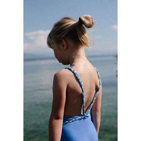 Girl wearing Indigo blue sun protective swimwear by Canopea