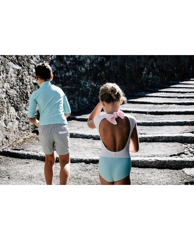 Girl wearing a bi-color Aqua sun protective swimwear for girls by Canopea