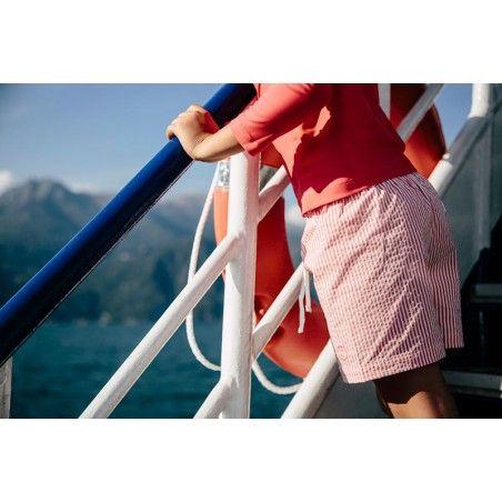 Boy wearing Fragola red seersucker swim shorts by Canopea