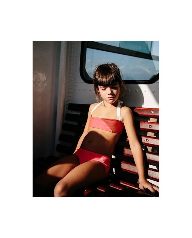Girl wear the Pitaya sun protective bikini for girls by Canopea