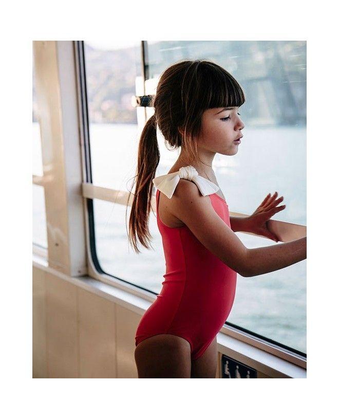 Girl wearing Fragola red sun protective swimwear by Canopea