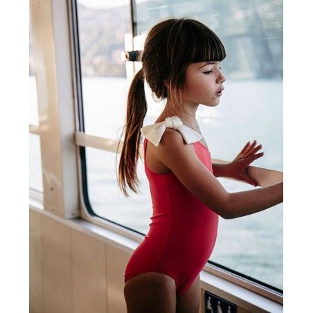 Girl wearing Fragola red sun protective swimwear by Canopea