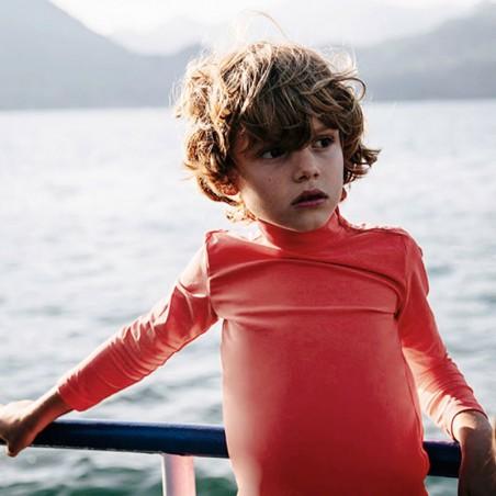Boy wearing a sun protective rashguard by Canopea