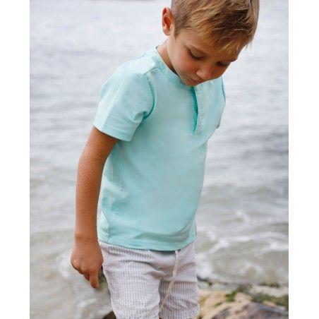Garçon portant un t-shirt anti UV Canopea vert aqua