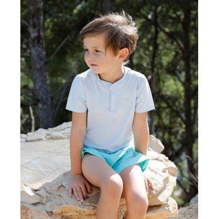 Garçon portant un t-shirt anti UV Canopea bleu Ash