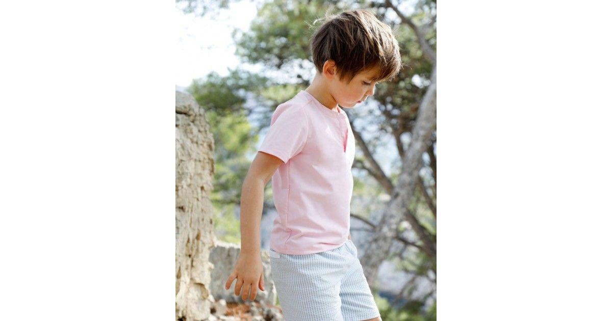 Boy wearing dragee pink sun protective rashguard by Canopea