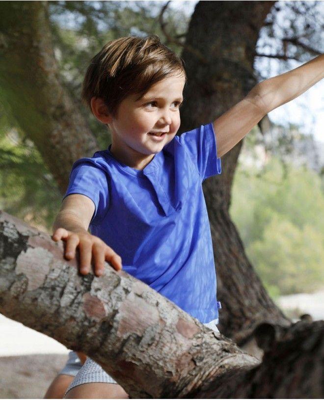 Boy wearing an Indigo blue sun protective rashguard  by Canopea